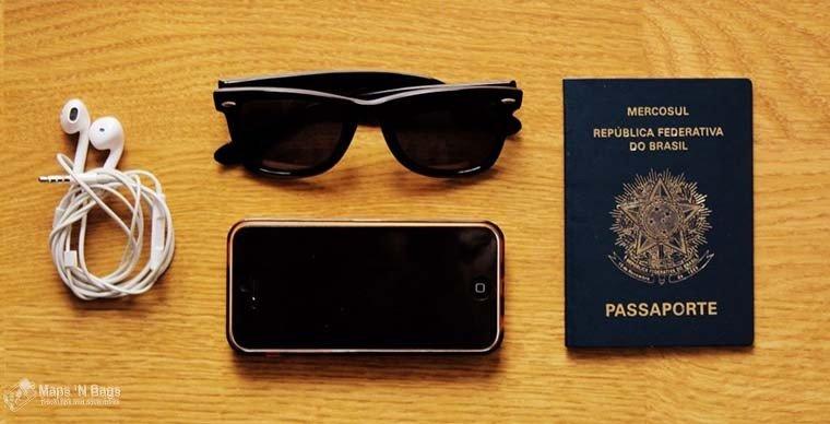 passport-sunglasses-iphone-earphones-wooden-floor-find-wanderlust