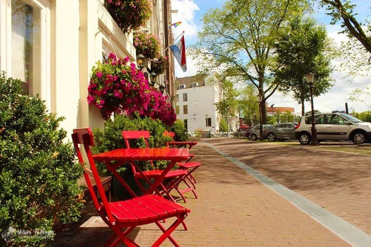 red-tables-chairs-sunny-street-find-wanderlust