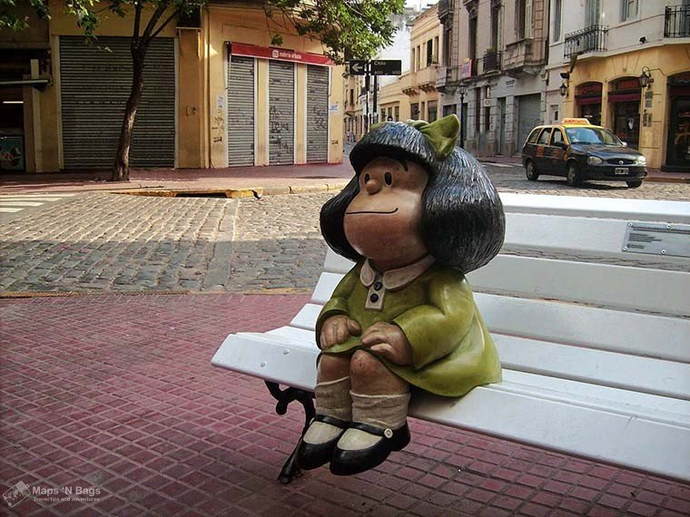 statue-girl-sitting-white-bench--3-days-buenos-aires
