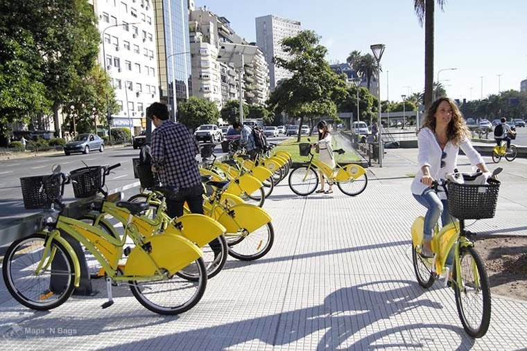 yellow-bikes-woman-riding-bike-public-transport-buenos-aires
