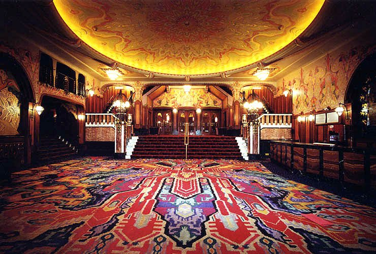 Vintage room with wooden furniture and red carpet in the Pathe Tuschinski movie theather in Amsterdam.