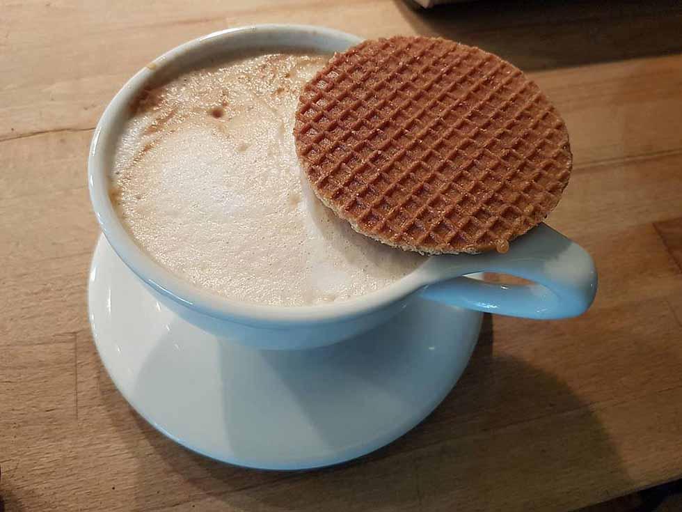Stroopwaffel on a mug with coffee in Amsterdam