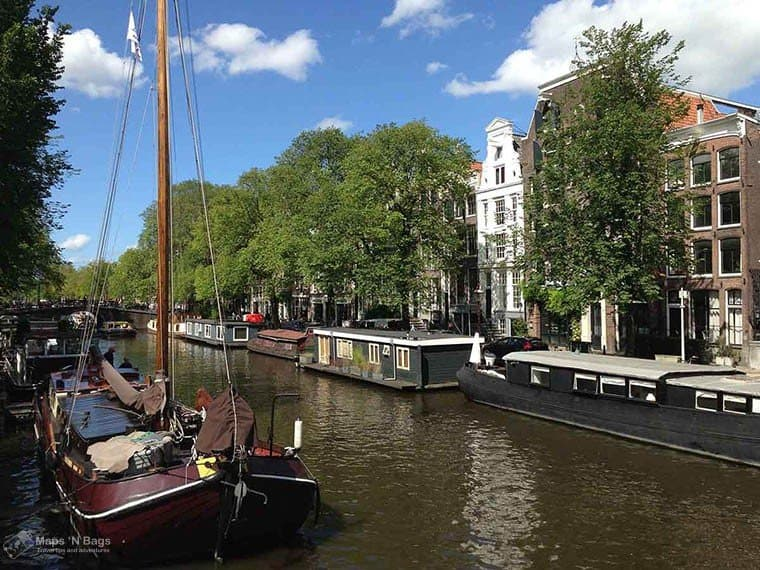 Boats on a canal in Amsterdam, the Netherlands, in a sunny day.
