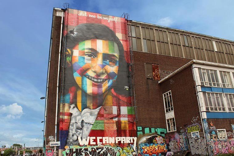 Colorful graffiti on a wall of Anne Frank at the NDSM in Amsterdam, the Netherlands.