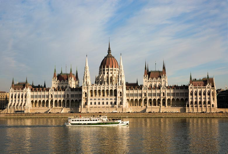 Building Hungarian parliament and boat cruising in the Danube river