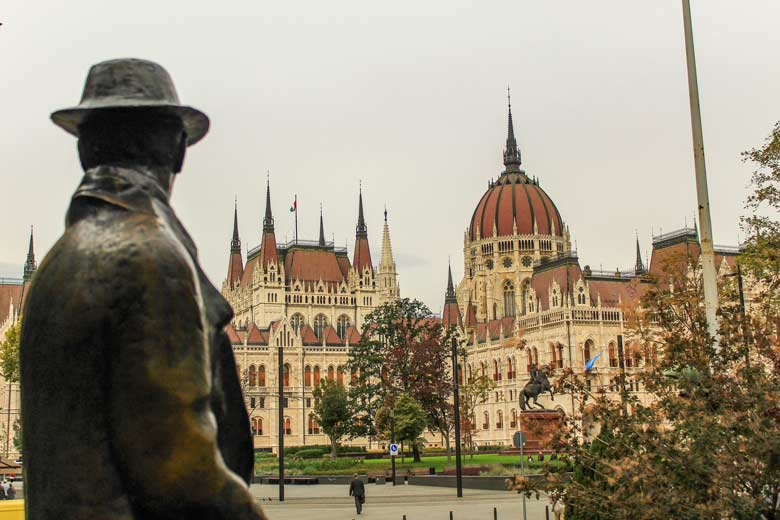 Imre Nagy statue looking at the Hungarian Parliament in Budapest