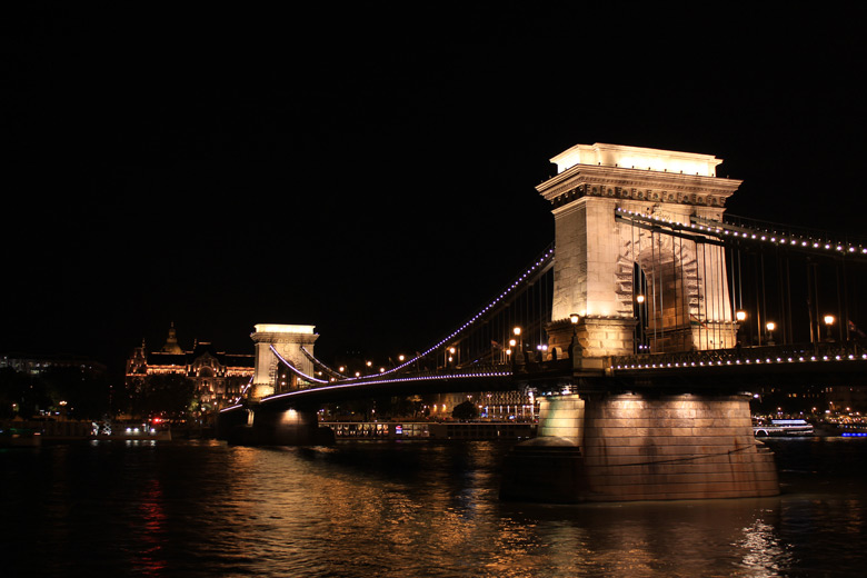 Chain Bridge lit up at night in Budapest