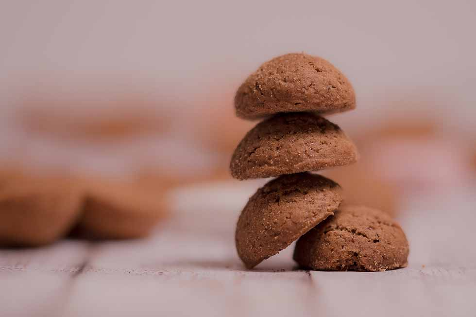 Brown little cookies piled onto each other, kruidnoten in Amsterdam