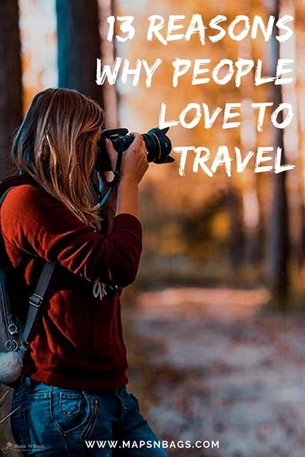 woman-red-sweater-photographing-wooden-path-13-reasons-why-people-love-to-travel