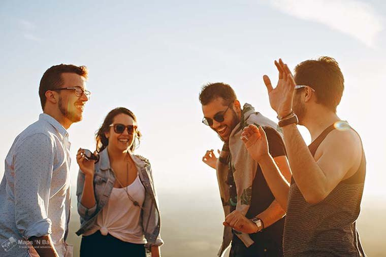 group-friends-talking-reasons-love-to-travel