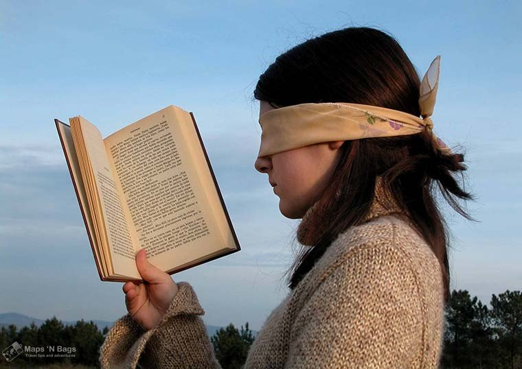 womaan-reading-book-blindfold-motives-study-language-abroad