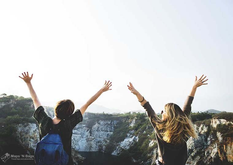 women-arms-up-horizon-reasons-love-to-travel