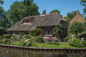 All information you need to know before visiting Giethoorn! Read about how to get there, best things to do in Giethoorn, and much more! Practical information for your trip to the Venice of the North! #travel #Netherlands #Europe #Giethoorn #Dutch #Holland #romantic #Daytrip #village #venice #pictures #photos #Howtogetto #Thingstodo