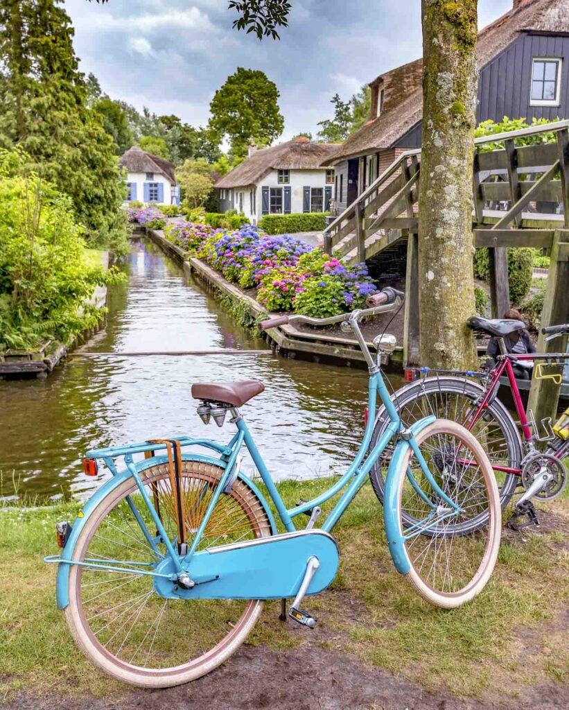 Blue bike near canal in Giethoorn, the Netherlands