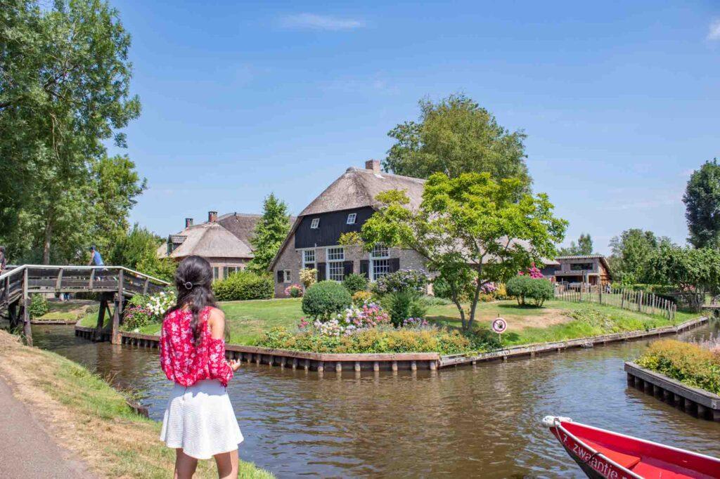 Brunette staring at a cottage in Giethoorn, the Netherlands