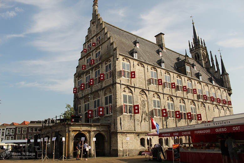 Old city hall of Gouda and a cheese stall in the main market.
