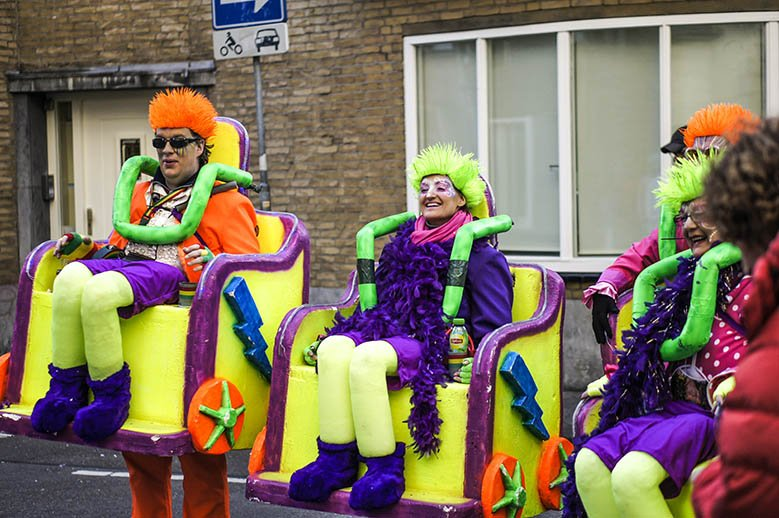 People wearing colorful costumes for carnival in Maastricht.