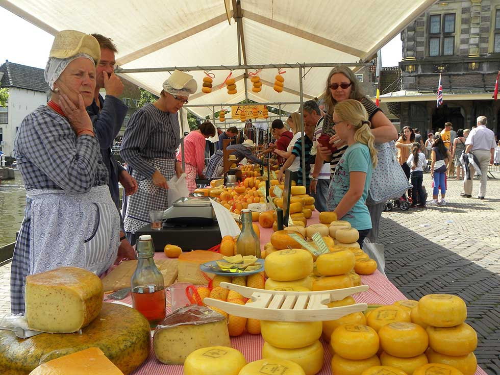 People in a cheese market in Alkmaar.
