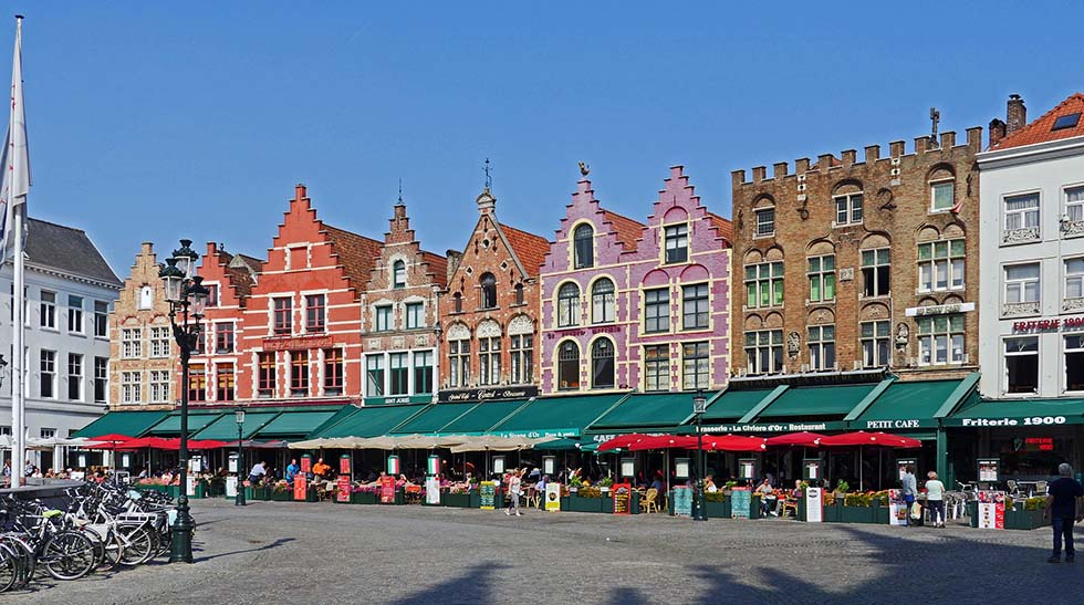 Colorful medieval houses next to each other at the market square in Bruges.