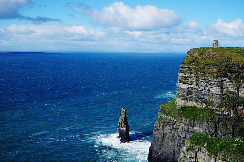 Sea stack and O'Brien Tower at the Cliffs of Moher at the Irish coast. #Ireland #CliffsofMoher #Europe #Travel