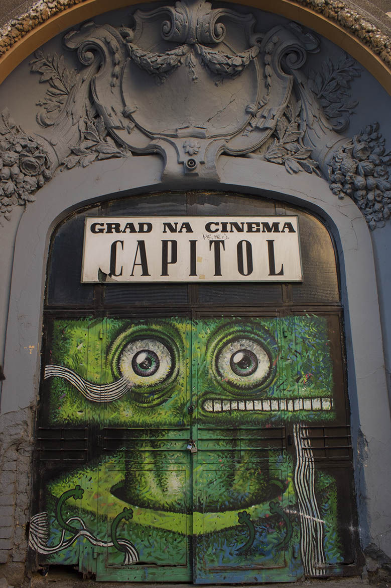 Summer Theatre Capitol in Bucharest with a green graffiti on its doors