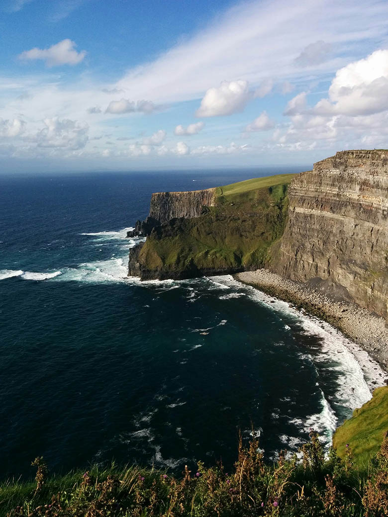 Cliffs of Moher in Claire County, Ireland, near the Atlantic Ocean in a sunny day #Ireland #CliffsofMoher #Europe #Travel
