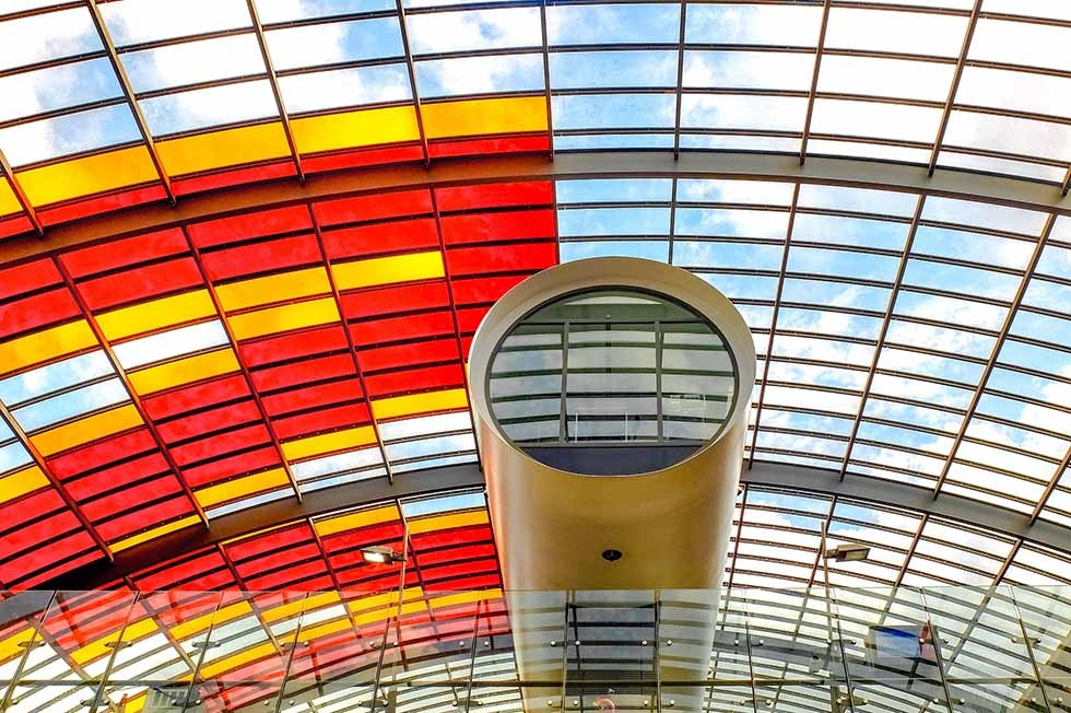 Round platform and ceiling of red and transparent glass at central station Amsterdam. #photospots #Amsterdam #TheNetherlands #Holland #cities #europe #dutch #travel #bicycles #interiors #Beautiful #architecture #inspiration #picture #photography