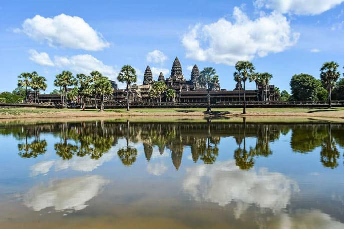 Angkor Wat in Cambodia. Water, blue sky and temple.