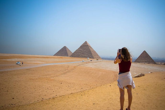 Girl and the pyramids of Egypt