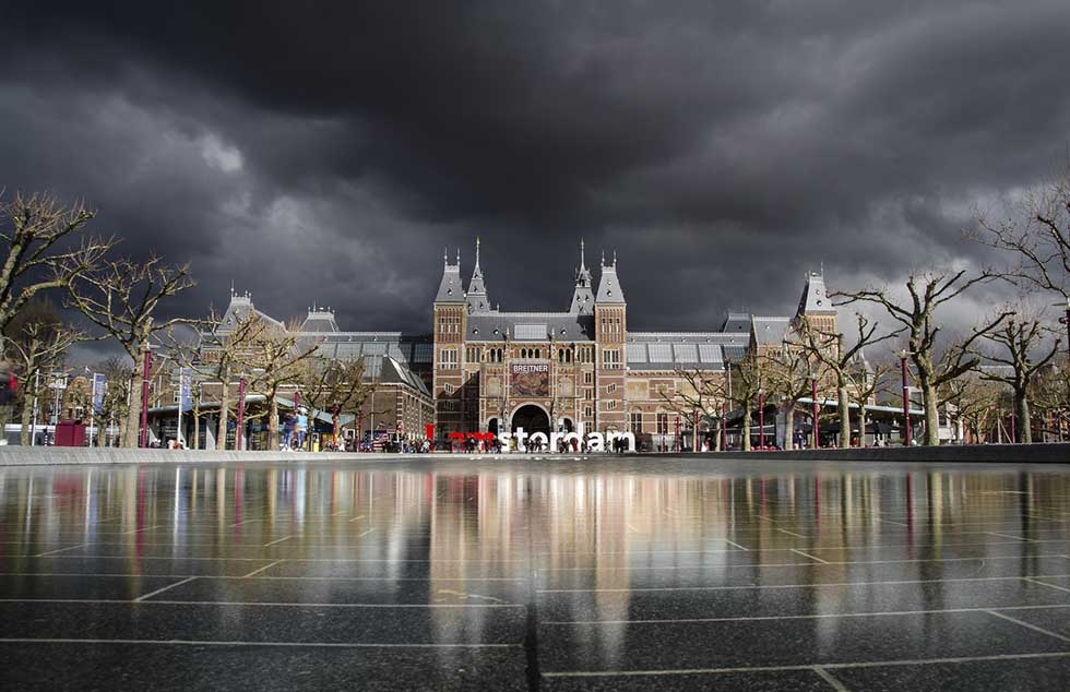 Rijksmuseum and Iamsterdam sign in a cloudy day in Amsterdam.