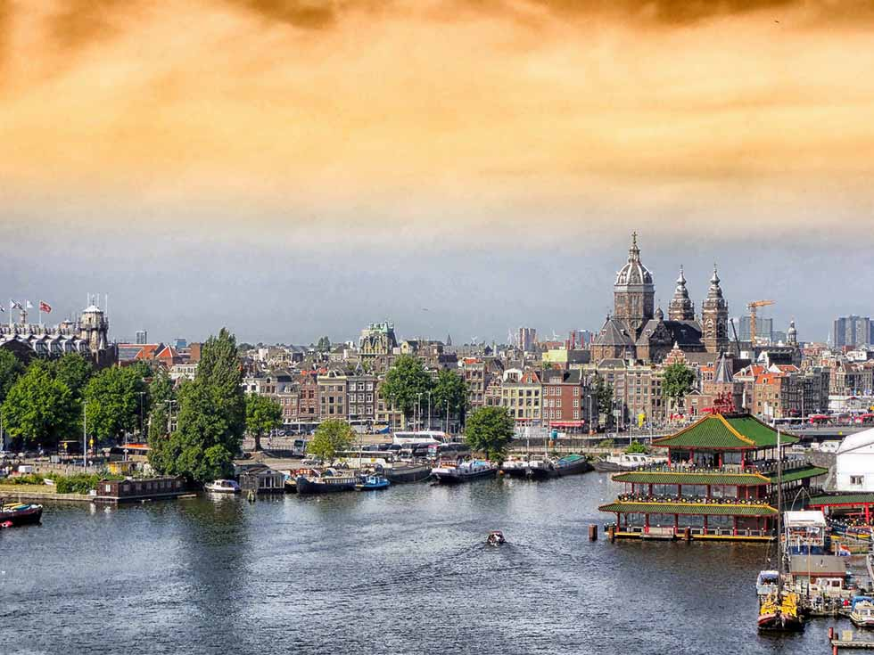 View over the water and the city of Amsterdam. #photospots #Amsterdam #TheNetherlands #Holland #cities #europe #dutch #travel #bicycles #interiors #Beautiful #architecture #inspiration #picture #photography