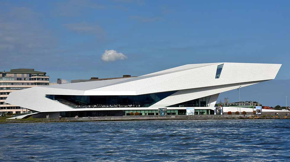 The Eye Film Museum, a horizontal white construction by the water's edge in Amsterdam. #photospots #Amsterdam #TheNetherlands #Holland #cities #europe #dutch #travel #bicycles #interiors #Beautiful #architecture #inspiration #picture #photography