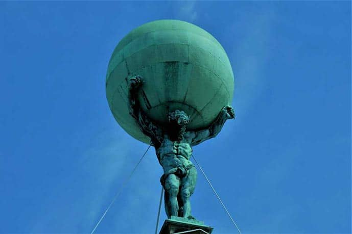 The Atlas statue at the Royal Palace is one of the best photo spots in Amsterdam