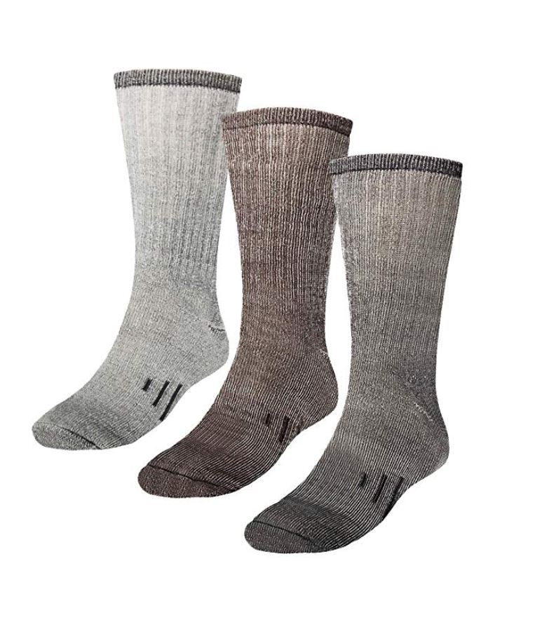 Three gray, woolen socks and a white background.