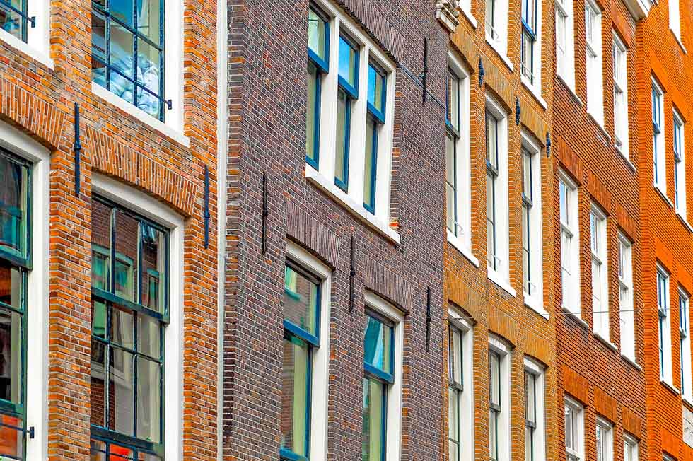 Diagonal photo of brick houses in Amsterdam, Jordaan. #photospots #Amsterdam #TheNetherlands #Holland #cities #europe #dutch #travel #bicycles #interiors #Beautiful #architecture #inspiration #picture #photography
