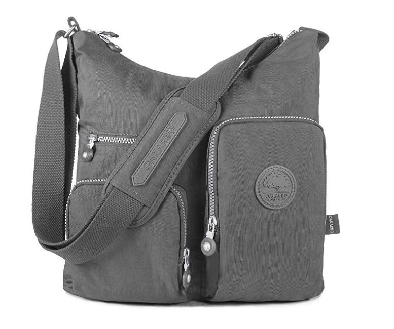 Gray crossbody bag for traveling in Europe.