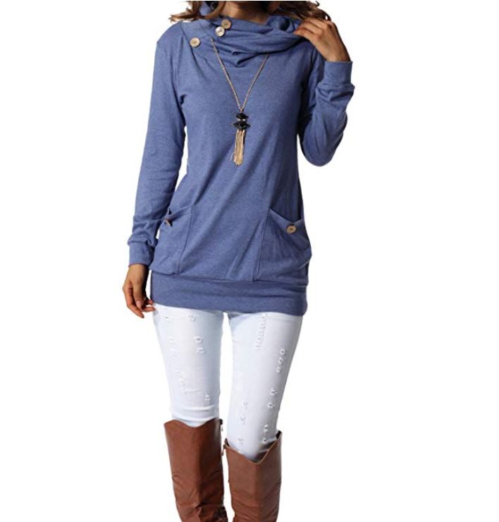 Woman's body wearing a blue long sleeved top, lights pants, and brown boots for winter in Europe.