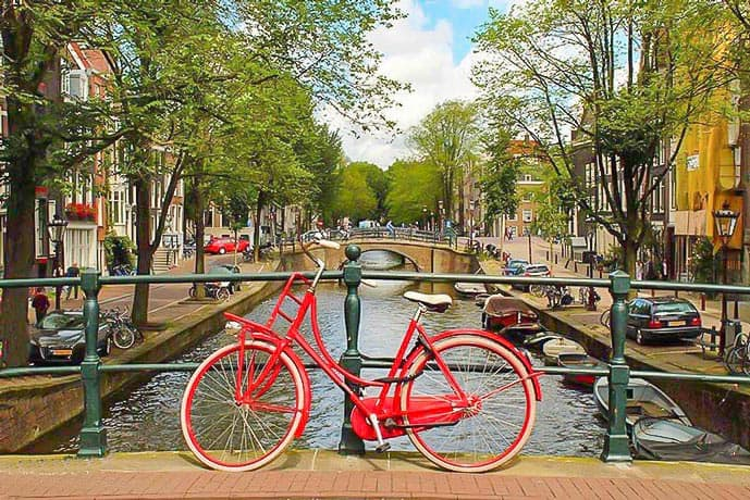 Red bike on a canal in an Amsterdam picture