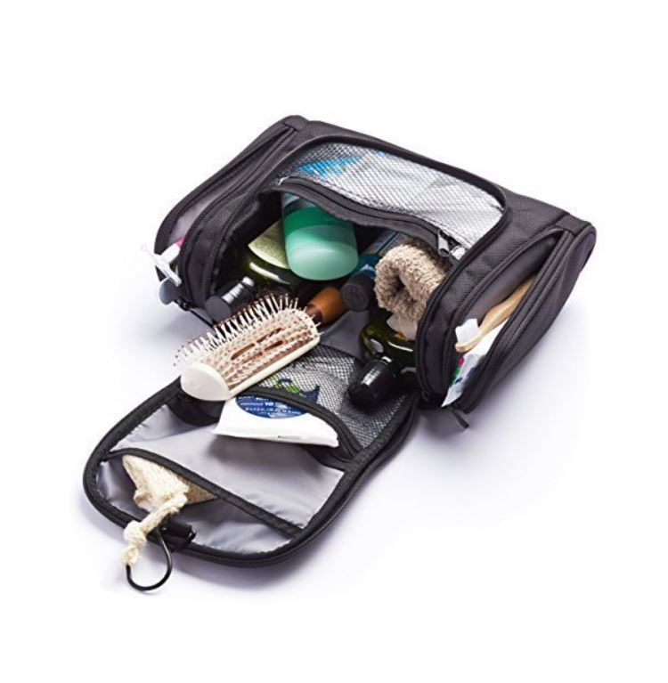 Open black toiletry bag with cosmetics.