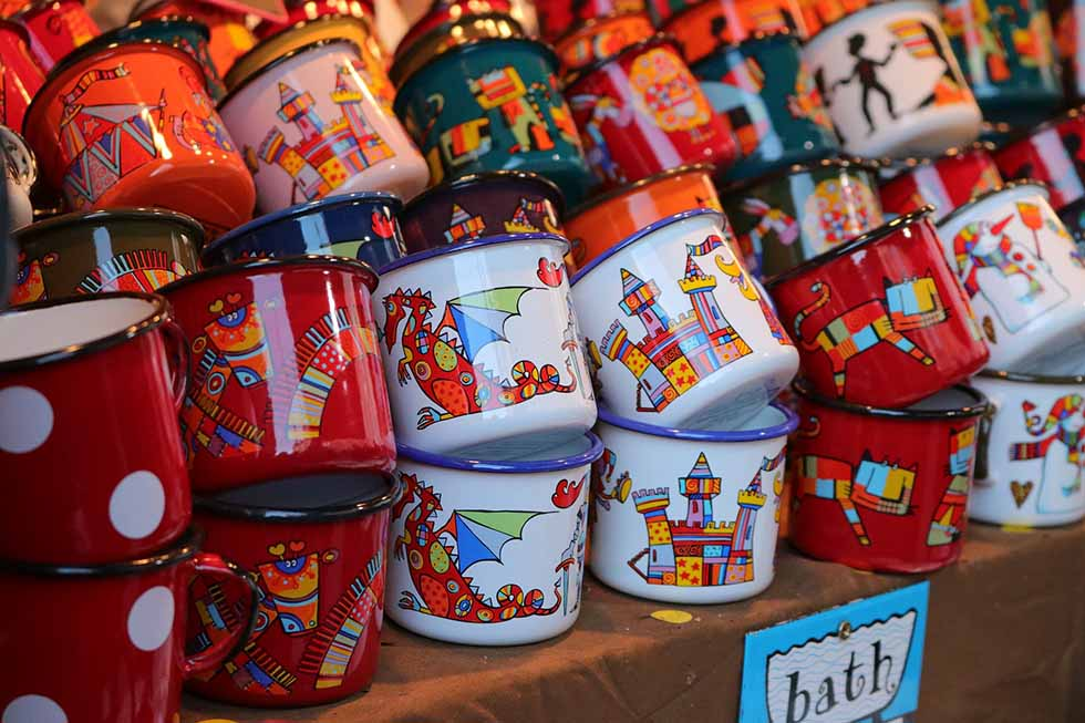 Red and white mugs at a Christmas market in Colmar.