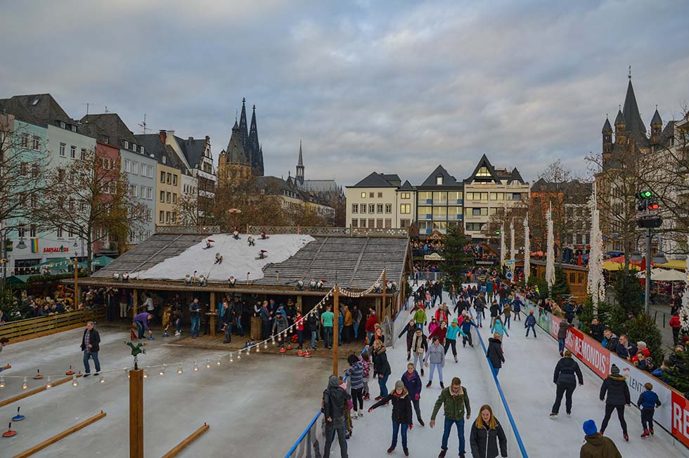 People ice skating in a Christmas market in Cologne.