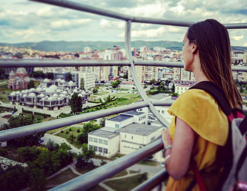 Brunette watching the view from the Saint Mother Teresa Cathedral in Pristina, Kosovo #Pristina #Kosovo #Travel #Europe