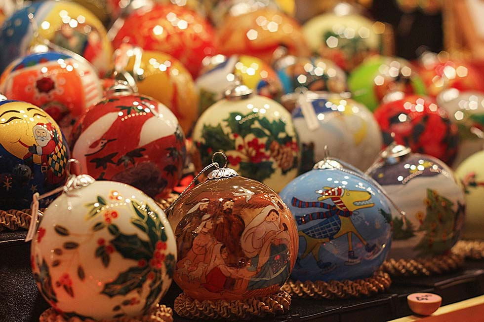 Many Christmas balls painted in different colors.