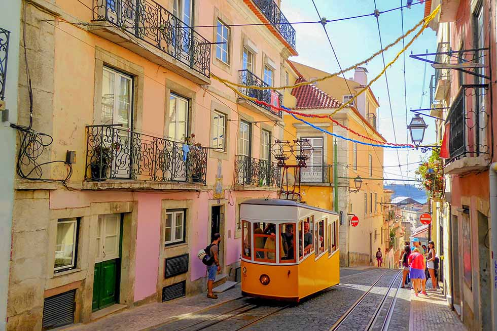 Yellow tram (ascensor da bica) in Lisbon #Portugal #travel #Europe