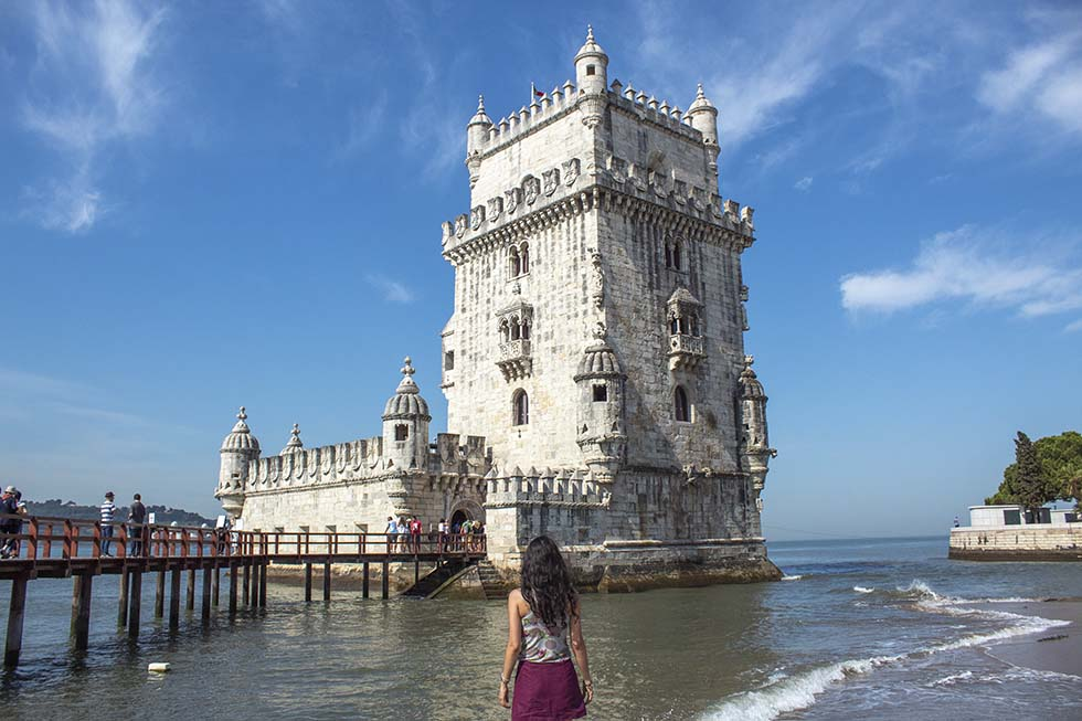 Brunette looking at the Belem Tower in Lisbon #Portugal #Europe #Travel