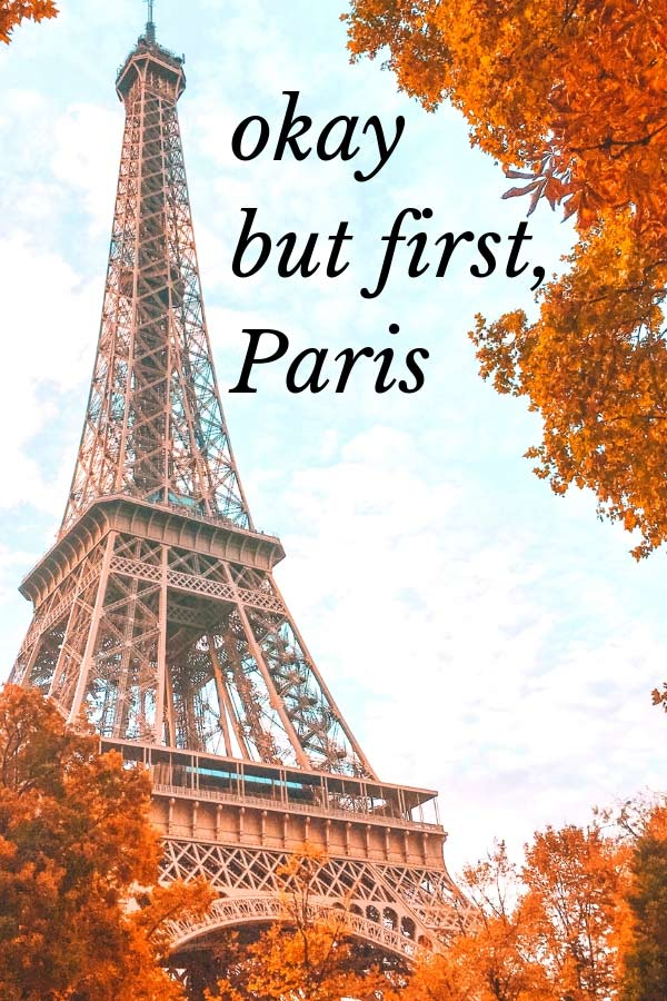 "Quote about Paris ""Okay but first, Paris"" in front of the Eiffel Tower"