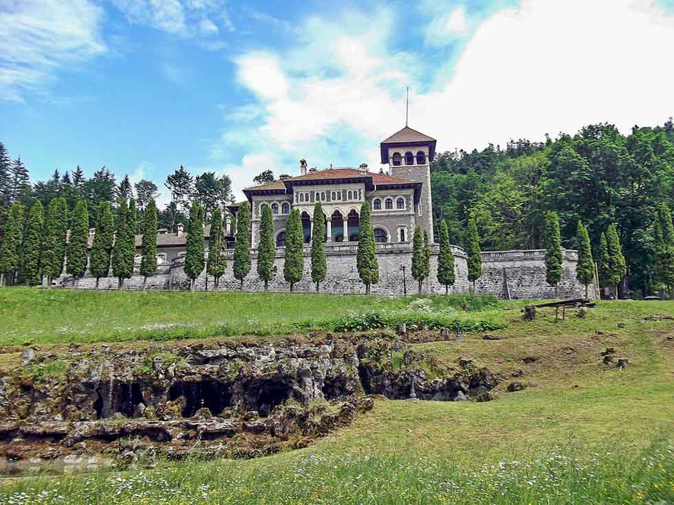 Cantacuzino Castle on a green hill in Romania