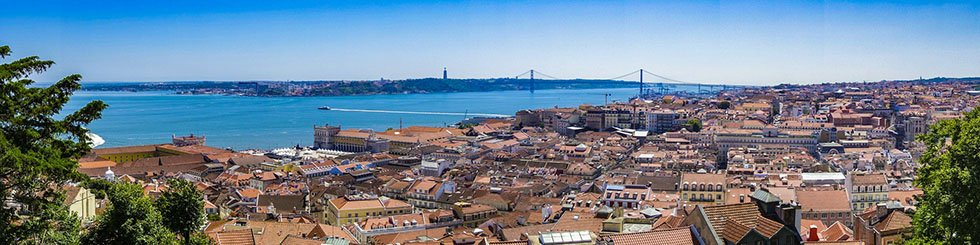 Panoramic view over houses and the Tagus River in Lisbon #Portugal #travel #Europe