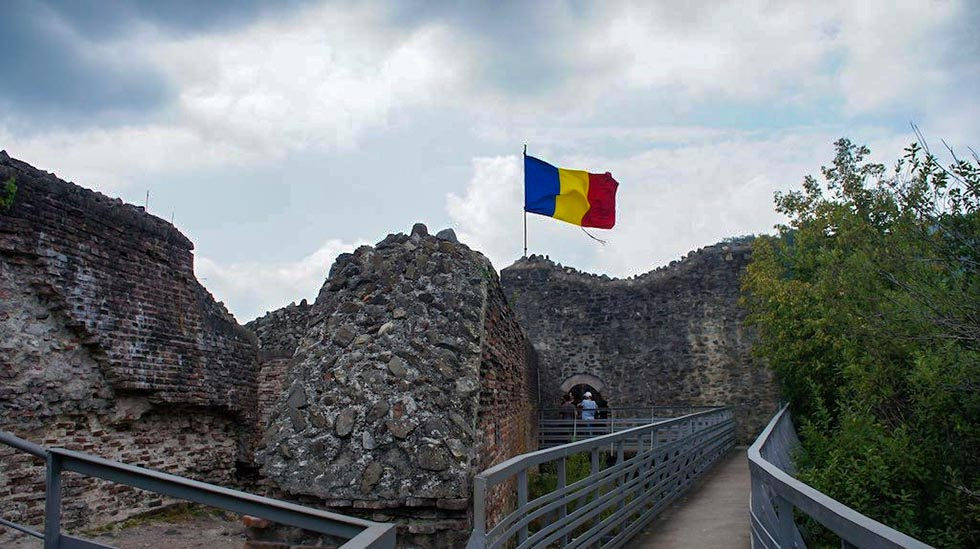 Romanian flag on the ruins of the Poenari Castle.