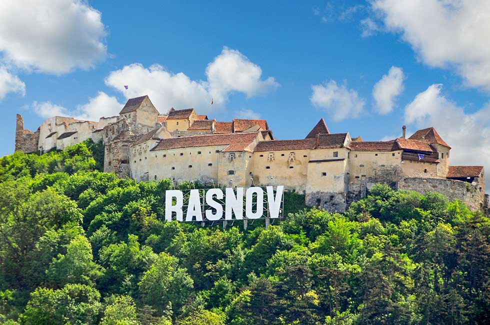 Rasnov board sign in front of the Rasnov citadel